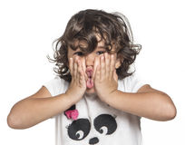 Little girl. Squeezing her cheeks Stock Photos