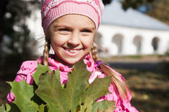 Little girl squints from sun Stock Photography