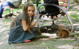 Little girl with squirrel Stock Photo