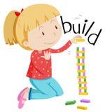 Little girl stacking the blocks Stock Images