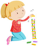 Little girl stacking wooden blocks Royalty Free Stock Photos