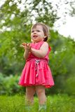 Little girl stading on meadow Royalty Free Stock Image