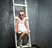 Little girl on stairs stock photography