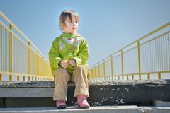 Little girl on the stairs looks away Royalty Free Stock Photography