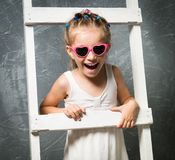 Little girl on stairs royalty free stock photography