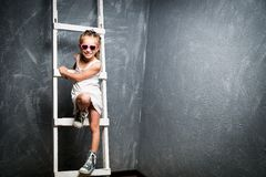 Little girl on stairs stock photos