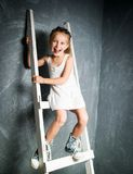 Little girl on stairs royalty free stock photo
