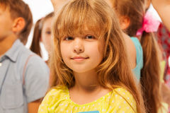 Little girl stand in the large group of friends Royalty Free Stock Photos