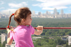 Little girl stand of roof of building Royalty Free Stock Images