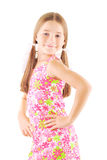 Little girl standing. On white background Royalty Free Stock Photography