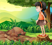 A little girl standing above the stump Royalty Free Stock Photo