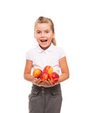 Little girl standing against white backdrop with few fresh necta Stock Photo