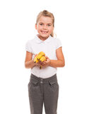 Little girl standing against white backdrop with three fresh ban Royalty Free Stock Images