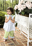 Little Girl Standing Barefoot Stock Photography