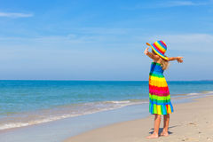 Little girl  standing on the beach Stock Images