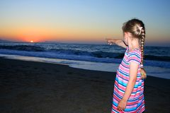 Little girl standing on the beach Royalty Free Stock Photos