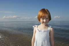 Little Girl Standing On Beach Royalty Free Stock Image