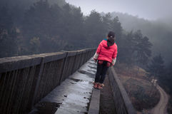Little girl standing on the bridge 3 Royalty Free Stock Photo