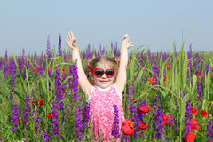 Little girl standing in colorful meadow Royalty Free Stock Image