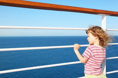 Little girl standing on deck of cruise ship royalty free stock image