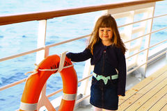 Little girl standing on deck of cruise ship Royalty Free Stock Images