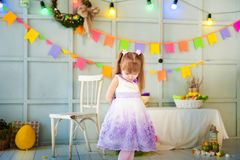 A little girl is standing in a decorated room stock photography