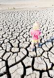 Little girl standing on dry land Stock Photography