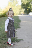 The little girl waits for the bus Stock Photography