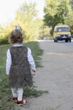 The little girl waits for the bus Stock Image