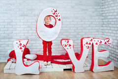 Little girl standing in front of decoration for St. Valentine's Royalty Free Stock Image