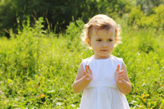 Little girl standing in grass Royalty Free Stock Photography