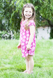Little girl standing in grass Royalty Free Stock Images