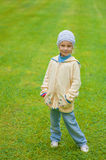 Little girl standing on green lawn Royalty Free Stock Photo