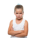 little girl standing and grins mischievously to the camera Royalty Free Stock Images