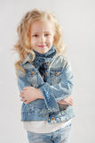 Little girl standing her arms crossed Royalty Free Stock Image