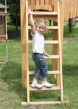 Little girl standing on ladder Royalty Free Stock Photo
