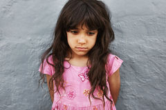 Little girl standing looking upset Royalty Free Stock Photos