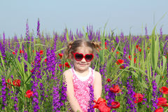 Little girl standing in meadow Royalty Free Stock Photos