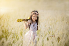 Little girl standing on meadow with sunset , outdoor in nature Stock Photo