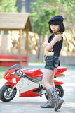 Little girl standing by the motorcycle royalty free stock photos