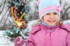 Little girl is standing near christmass tree Stock Photography
