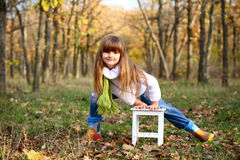 Little girl standing near white chair outdoors Stock Photography