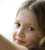 Little girl standing next to the window Stock Photography