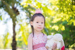 Little girl standing in park Royalty Free Stock Photos