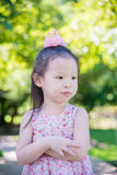 Little girl standing in park Stock Images