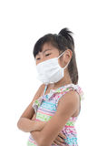 Little girl standing in protective mask. White mask, on white background with copy space for health concept Royalty Free Stock Images