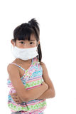Little girl standing in protective mask. White mask, on white background with copy space for health concept Stock Photography