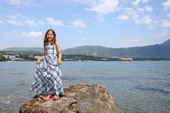 Little girl standing on rock near sea Corfu island summer Royalty Free Stock Photos