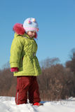 Little girl standing in snow outdoors at winter Royalty Free Stock Photos