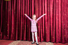 Little girl standing on stage during a performance Stock Image